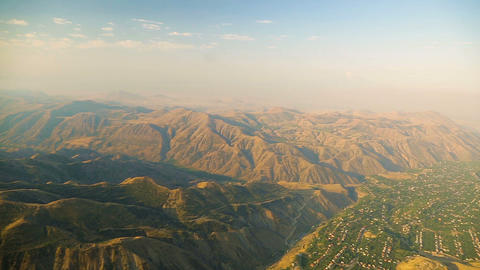 Magnificent aerial view of Armenian highlands and valley, blurred cloudy horizon Footage