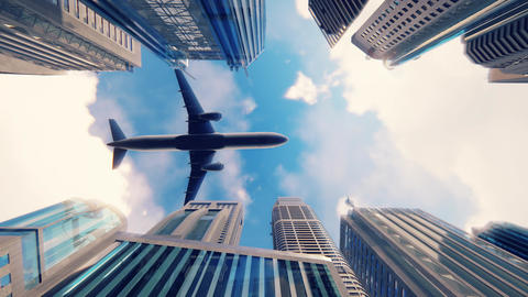 Airplane flies over a modern megapolis at sunrise in slow motion GIF