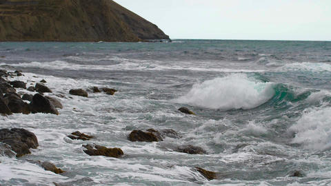 Boiling tide come to shore Slow motion video Live Action