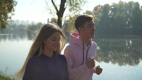 Young couple on the morning run in the park Footage
