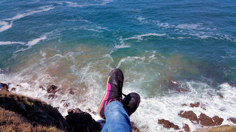 Top view from the cliff to the feet above the surf Photo