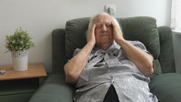 Old woman is having headache. Face expression Footage
