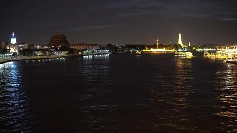 Illuminated night landmarks and trip boats on skyline Footage