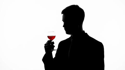 Experienced male taster silhouette drinking old red wine, enjoying bouquet Footage