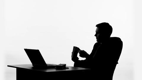 Man sitting in office and counting bundle of money, wealthy male silhouette Live Action