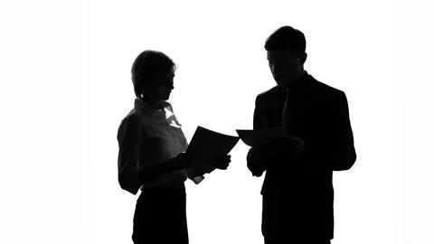 Black-and-white boss screaming at his secretary because of mistakes in documents Footage
