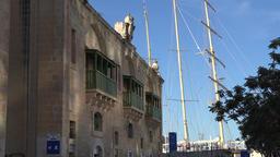 Malta Valletta Maltese house facade and mast of a windjammer sailing ship ビデオ