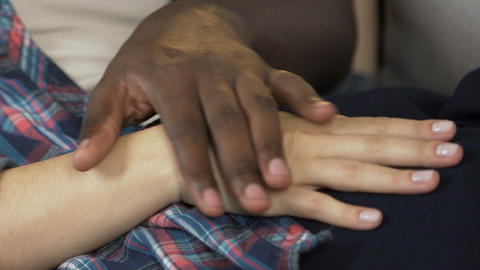 African man stroking wife hand, multi-racial relationship, romantic tenderness Live Action