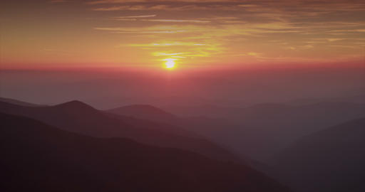 Mountain timelapse of sunset. Silhouettes of hills are dark. Sky with airplanes Footage