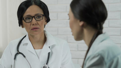 Unhappy woman complaining about disease to gynecologist, incurable illness Footage
