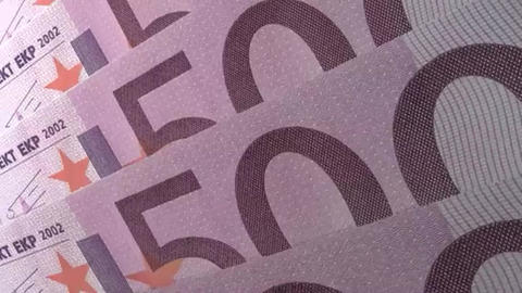 Abstract financial close up detail of the numerals on angled 500 Euro Banknotes Footage