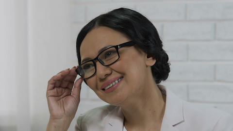 Asian business woman listening to visitor, face of rich successful adult female Live Action