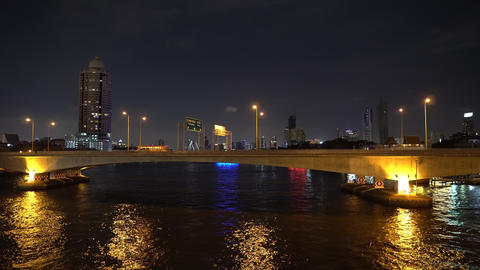 Cityscape of big modern skyscrapers at night on skyline and large building above GIF