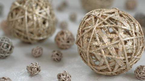 Christmas composition. Golden vine balls. 4K resolution trucking shot. Shallow depth of field Live Action