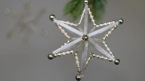 Original vintage ornaments spinning while hanging on conifer branch. 4K resolution pedestal camera Live Action