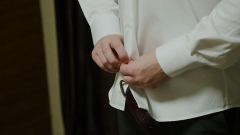 The man fastens his shirt Footage