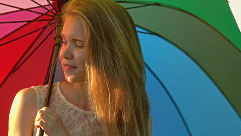 Cute girl with a multicolored umbrella Footage