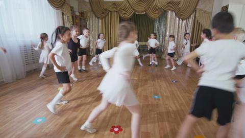 small children group learns active joyful dance in class 영상물