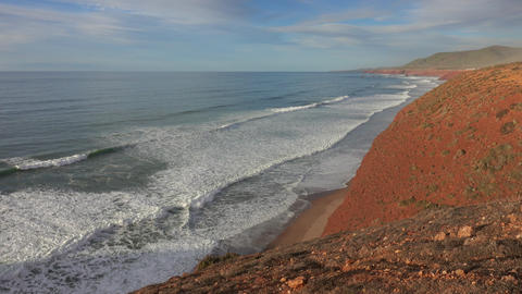 Legzira beach with arched rocks in Morocco Live Action