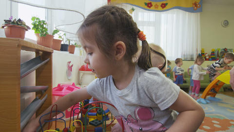 close view cute children play with bright colored toys Footage