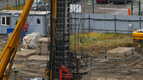 huge drilling rig at the construction site Live Action