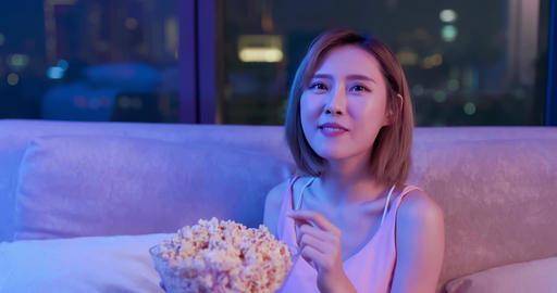 woman watch movie with popcorn Footage
