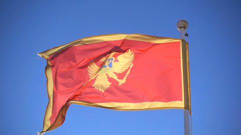 Montenegro flag flying in the background of the sky Footage