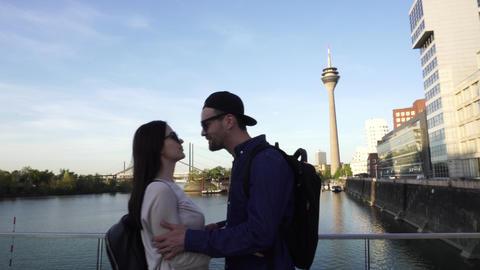 Happy Caucasian Couple Meet Kiss Hug, Rheinturm Rhine Tower, Dusseldorf GIF