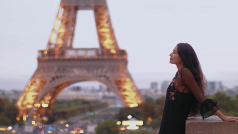 Parisian woman near the Eiffel tower in Paris, France Footage