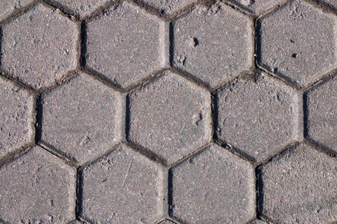 Hexagon pattern cement sidewalk Photo