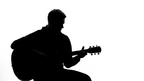 Talented musician playing guitar at audition, performing song, entertainment Footage