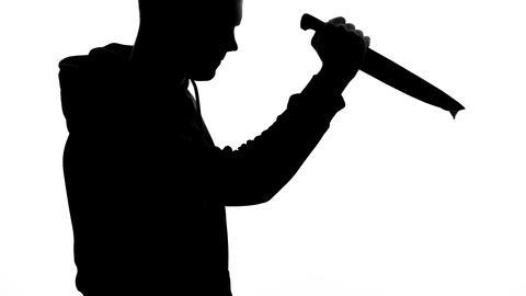 Aggressive killer holding sharp bloody knife, murder weapon, danger and horror Live Action