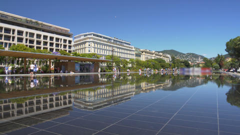 Mirror-like surface of fountain at Promenade du Paillon park in Nice, France Live Action