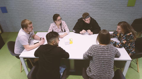 Business meeting of young creative people. Discussion of... Stock Video Footage