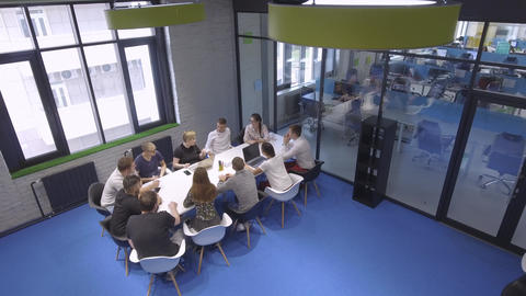 Top view of the team of creatives in a beautiful office Live Action