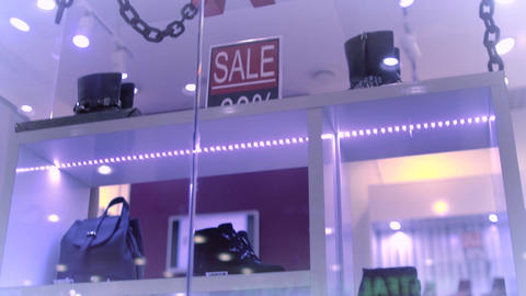 The letters are moving in the shop window. The Shoe sale Live Action