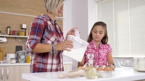 Mother and young daughter together at the kitchen Stock Video Footage