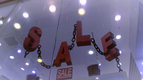The letters are moving in the shop window. soon sale Footage
