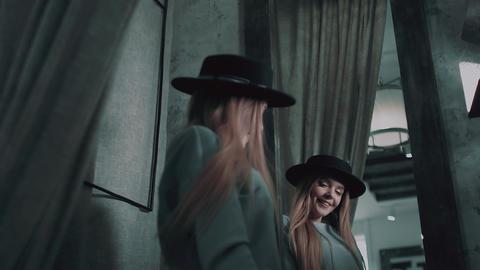 blonde in a black hat Footage