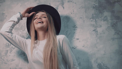 Girl model posing near the wall showing different emotions Footage