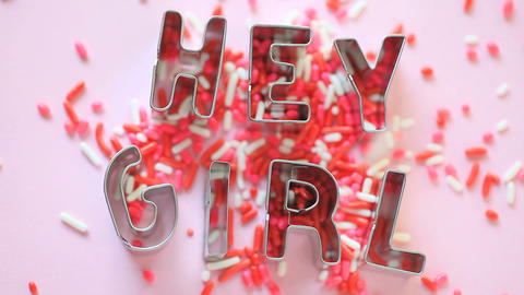 Hey Girl words with candy sprinkles Footage