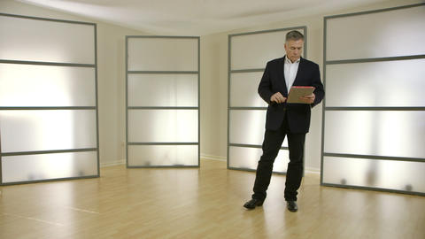 businessman using a tablet pc in a modern office Footage