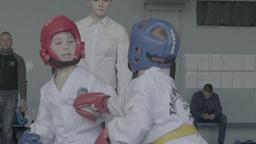 Fight Taekwondo among children . Children's sports. Slow motion Footage