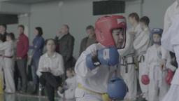Children's sports. Fight Taekwondo among children . Slow motion Footage