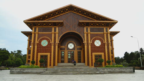Ornamented wooden facade of Summer Theater in Batumi, cultural events venue Live Action