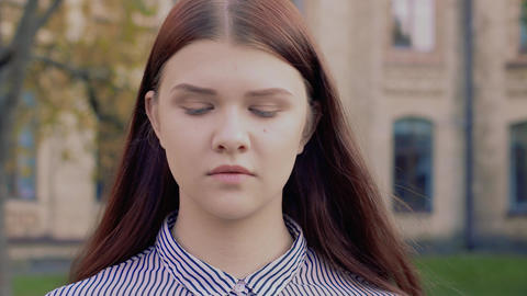 Emotional video-portrait of offended beautiful young girl Footage