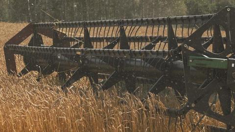 Combine harvester blades threshing wheat field GIF