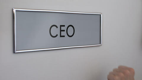Chief executive officer door, hand knocking closeup, company management, boss Live Action