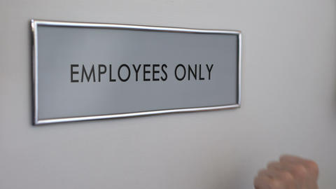 Employees only room door, hand knocking closeup, entrance restriction, workplace Live Action