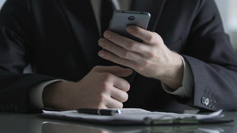General director calling corporate partner, managing work problem by smartphone Footage